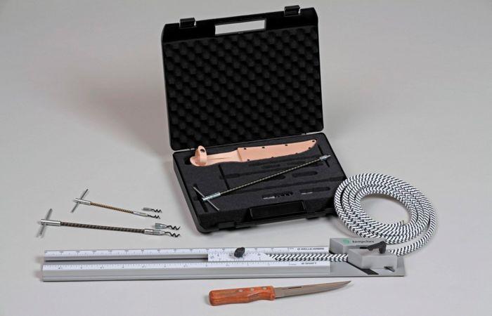 Montageset mit Packungszieher, Messer und Schneidevorrichtung